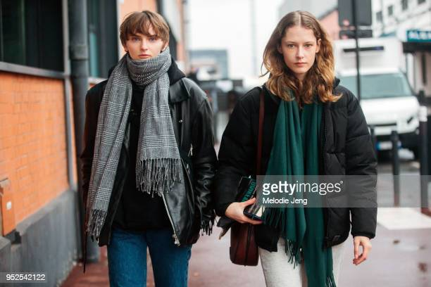 Polish models Oliwia Lis Maria Zakrzewska after the Balenciaga show on March 04 2018 in Paris France Oliwia wears a gray patterned scarf black jacket...