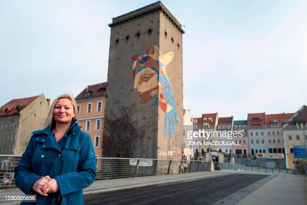 Polish national and former UK resident Izabela Jucha poses on the Old Town Bridge , a pedestrian bridge over the Neisse river that links the German...