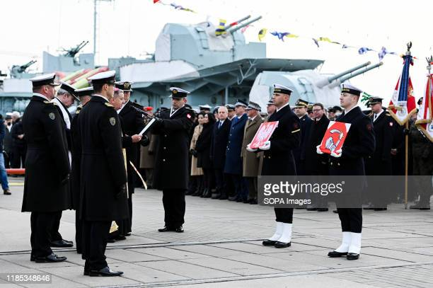Polish Navy officers hold flags during the 101st anniversary of the creation of the Polish Navy During the ceremony for the first time war flag of an...