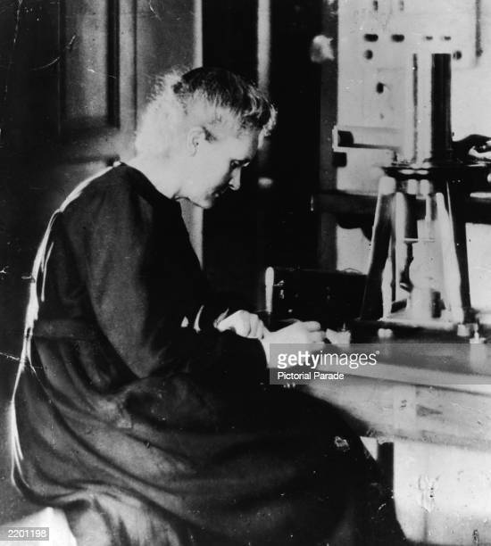 Polish Nobel Prizewinning chemist Marie Curie working at her laboratory desk next to a large burner c 1920