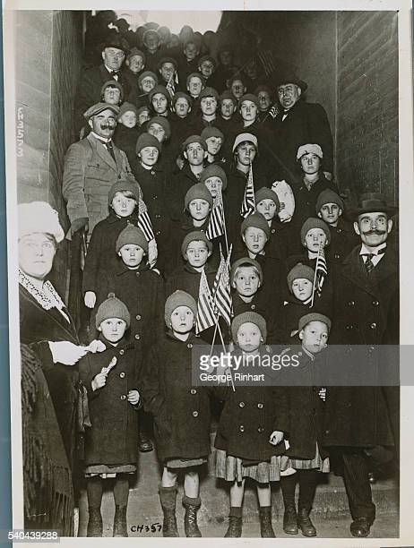 Polish Orphans Reach Chicago from Siberia. Chicago, Illinois: After traveling from far off Siberia, fifteen orphan boys and girls, ranging from 4 to...