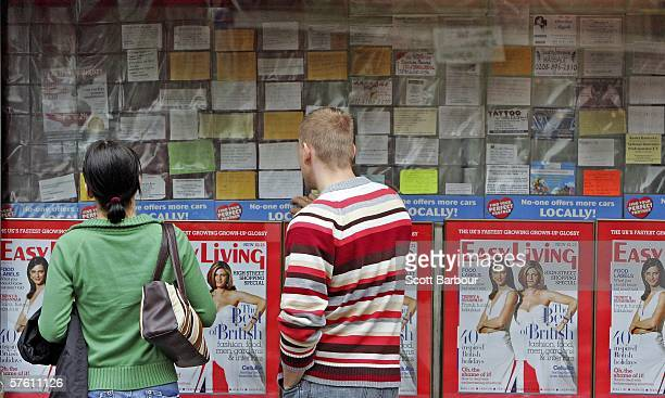 Polish people look at a job message board outside a shop in an area popular with Polish people on May 15 2006 in west London England Following...