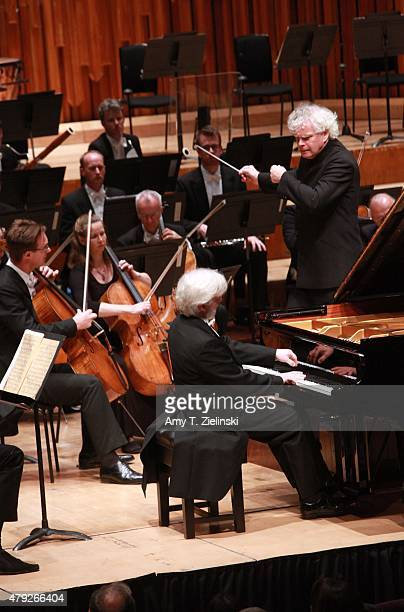 Polish pianist Krystian Zimerman performs Brahms's First Piano Concerto with conductor Sir Simon Rattle leading the London Symphony Orchestra at...