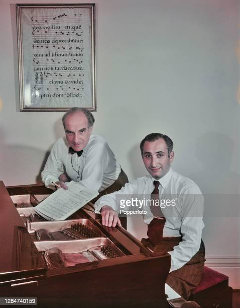 Polish pianist Marjan Rawicz on left and Austrian pianist Walter Landauer of piano duo Rawicz and Landauer posed together at a piano in England in...