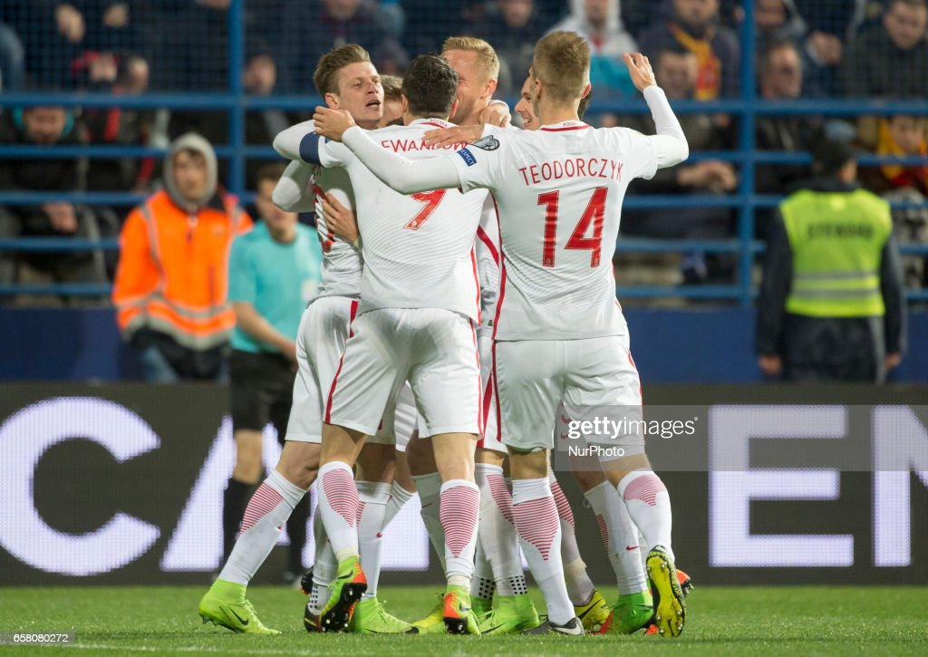 Polish players celebrate after Lukasz Piszczek goal during the FIFA World Cup 2018 Qualifying Round Group E match between Montenegro and Poland at Gradski Stadion in Podgorica, Montenegro on March 26, 2017