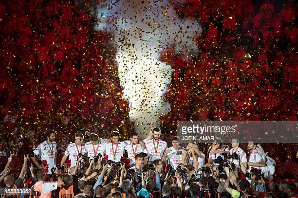Polish players celebrate with the trophy after winning the FIVB Mens Volleyball World Championship final match between Brazil and Poland at the...