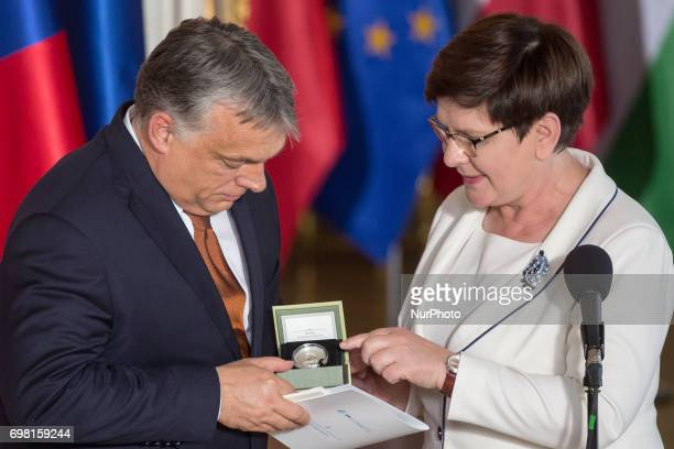 Polish PM Beata Szydlo hands over the presidency of the Visegrad Group to Hungarian Prime Minister Viktor Orban during the Visegrad Group meeting at...