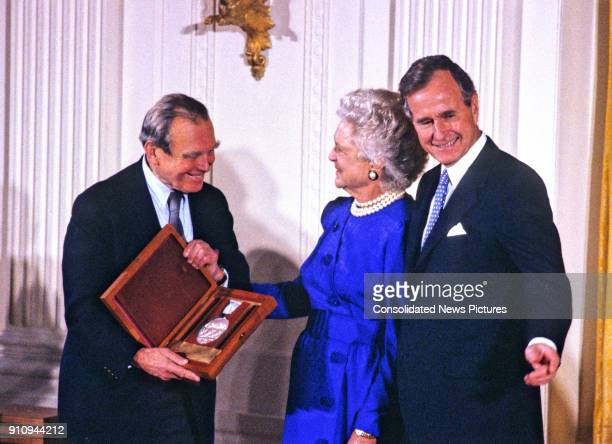 Polish poet and author Czeslaw Milosz is awarded the National Medal of Arts by US First Lady Barbara Bush and President George HW Bush during a...