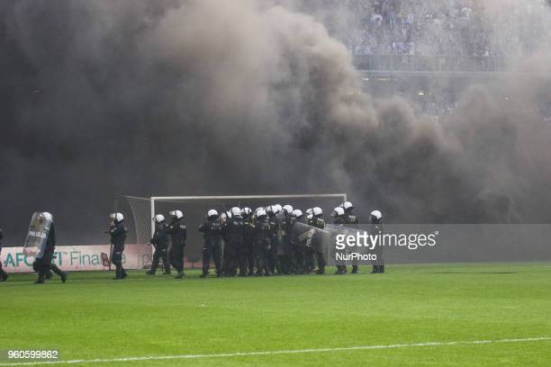 Polish police controls fans during Playoff Polish League football match between Lech Poznan and Legia Warsaw at Miejski Stadium in Poznan Poland on...