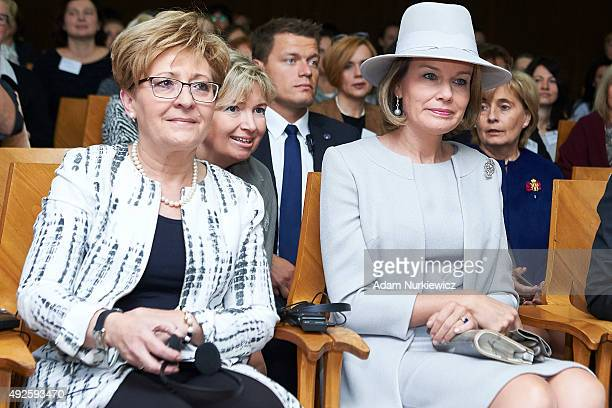 Polish politician Elzbieta Radziszewska and Queen Mathilde of Belgium sit during a conference on child development at House of Literature as part of...