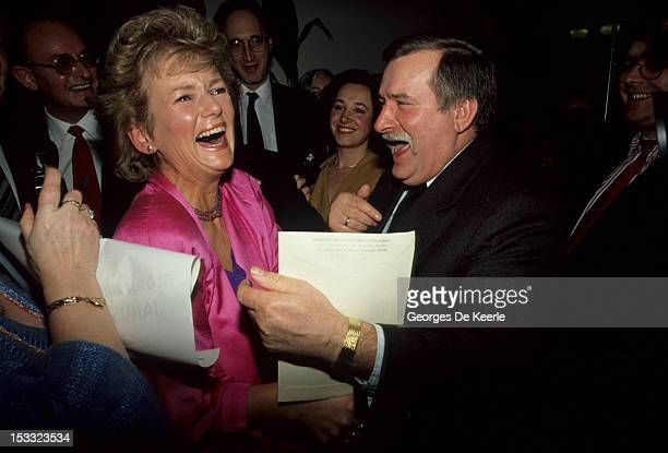 Polish politician Lech Walesa embraces Glenys Kinnock wife of British Labour party leader Neil Kinnock during a visit to a Polish community in...