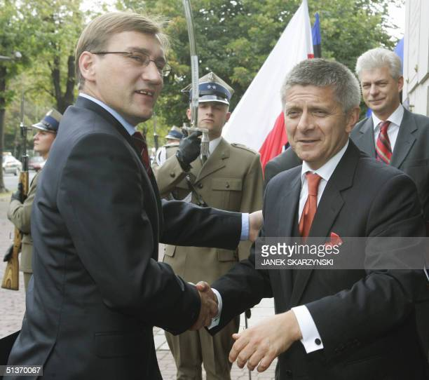Polish Premier Minister Marek Belka shakes hands with his Estonian counterpart Juhan Parts during their meeting in Warsaw, 29 September 2004. Parts...