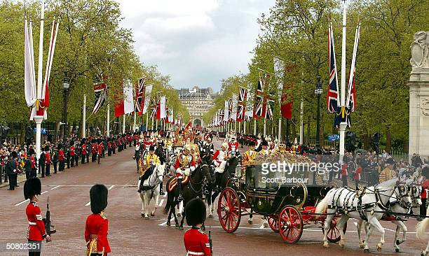 Polish president Aleksander Kwasniewski rides in a horse drawn carriage with HRH Queen Elizabeth II during the first day of his state visit on May 5...