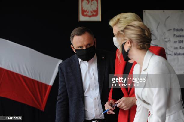 Polish president and candidate to his succession for the Law and Justice party Andrzej Duda his wife Agatha and his daughter Kinga vote on July 12...