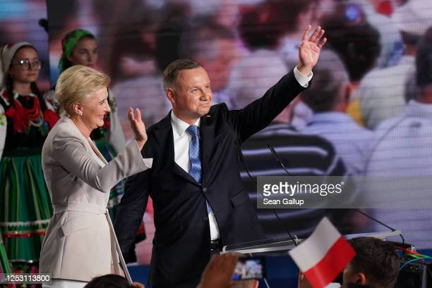 Polish President and member of the right-wing Law and Justice party Andrzej Duda and his wife, Agata Kornhauser-Duda, wave to supporters following...