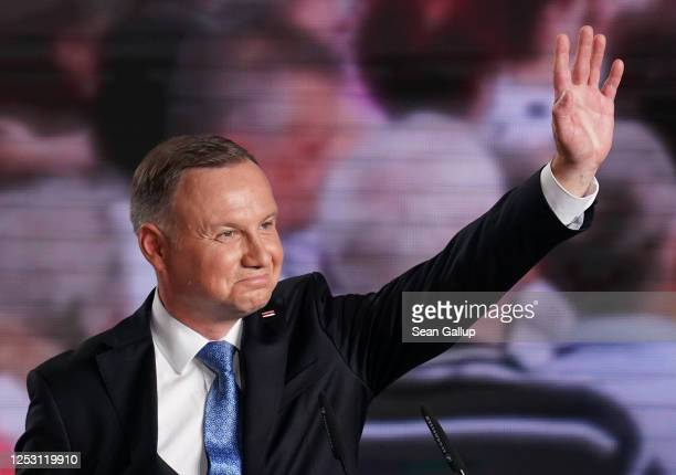 Polish President and member of the right-wing Law and Justice party, Andrzej Duda waves to supporters following initial results in the Polish...