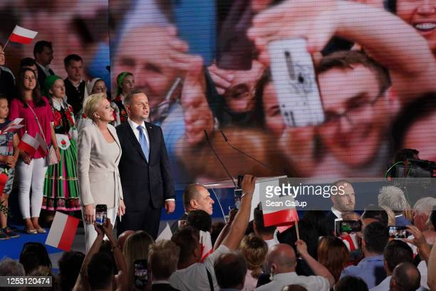 Polish President and member of the right-wing Law and Justice party, Andrzej Duda and his wife, Agata Kornhauser-Duda, sing the Polish national...