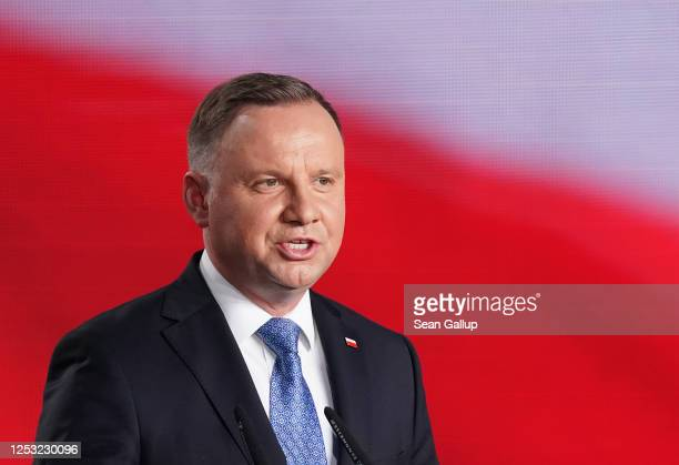 Polish President and member of the right-wing Law and Justice party Andrzej Duda speaks to supporters following initial results in the Polish...