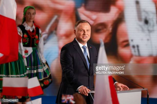 Polish President Andrzej Duda addresses supporters as exit poll results were announced during the presidential election in Lowicz Poland on June 28...
