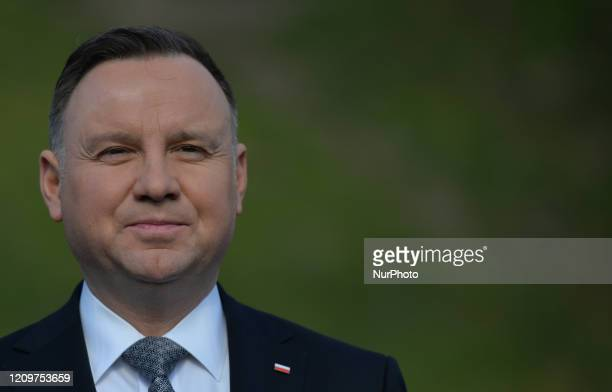 Polish President Andrzej Duda addresses the media outside Wawel castle on his return from the visit of a sarcophagus where President Lech Kaczynski...