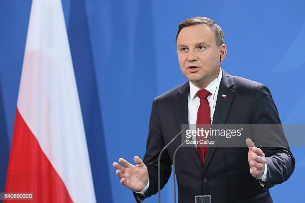 Polish President Andrzej Duda and German Chancellor Angela Merkel give statements to the media prior to talks at the Chancellery on June 17, 2016 in...