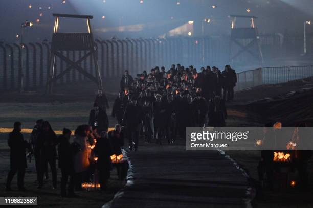 Polish President Andrzej Duda and Polish First Lady Agata Kornhauser-Duda lead official delegations to lay candles at the Auschwitz Memorial during...