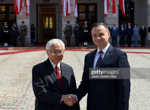 Polish President Andrzej Duda and Singapore's President Tony Tan Keng Yam shake hands during a welcoming ceremony at the court of the presidential...