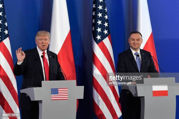 Polish President Andrzej Duda and US President Donald Trump hold a joint press conference at the Royal Castle in Warsaw Poland July 6 2017 / AFP...