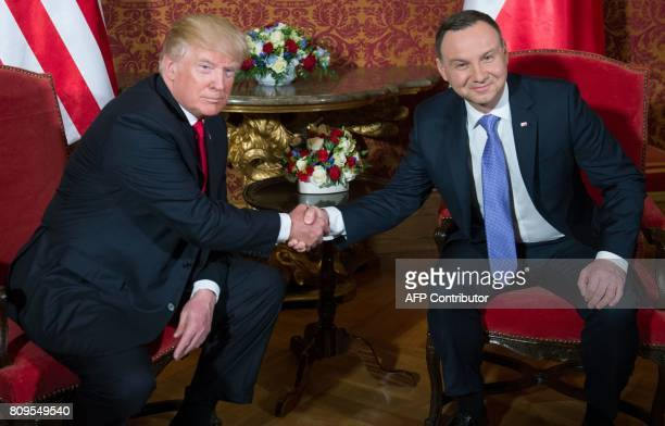 Polish President Andrzej Duda and US President Donald Trump shake hands prior to a meeting at the Royal Castle in Warsaw Poland July 6 2017 / AFP...