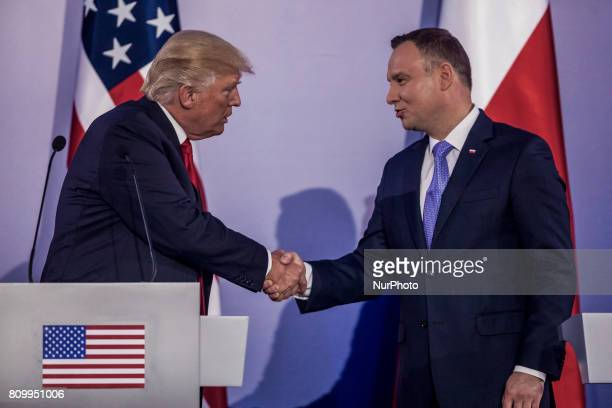 Polish President Andrzej Duda and US President Donald Trump shake hands after holding a joint press conference at the Royal Castle in Warsaw Poland...