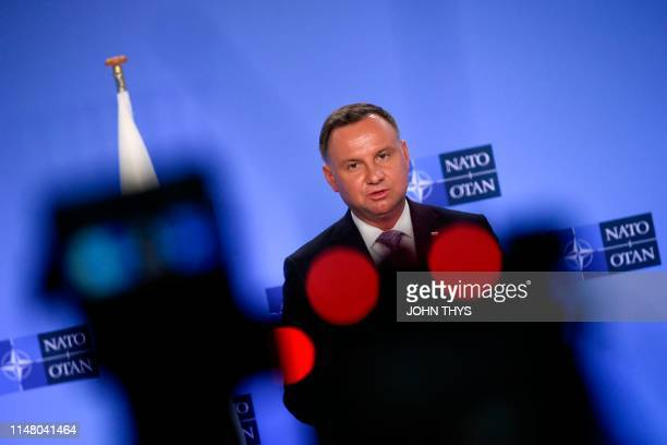 Polish President Andrzej Duda gestures as he speaks during a joint press with NATO Secretary General after a bilateral meeting at the Nato...