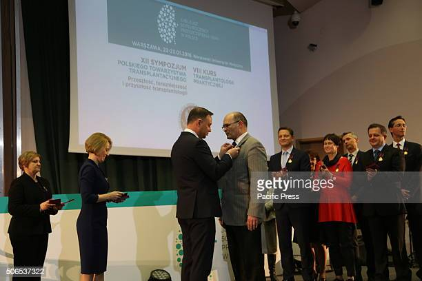 Polish President Andrzej Duda presents Grzegorz Senatorski the Golden Cross of Merit during the 50th anniversary symposium of the first successful...