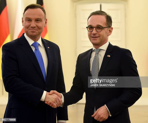 Polish President Andrzej Duda shake hands with German Foreign Minister Heiko Maas during his inaugural visit on March 16 2018 in Warsaw / AFP PHOTO /...