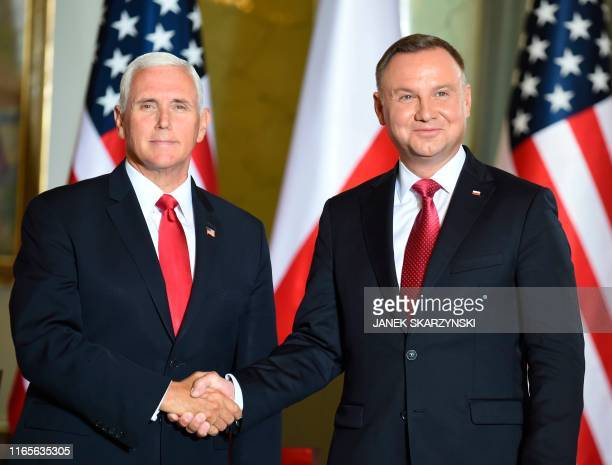 Polish President Andrzej Duda shakes hand with US Vice President Mike Pence during a meeting in Warsaw on September 2 2019