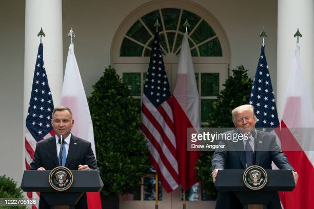 Polish President Andrzej Duda speaks as U.S. President Donald Trump looks on during a joint news conference in the Rose Garden of the White House on...