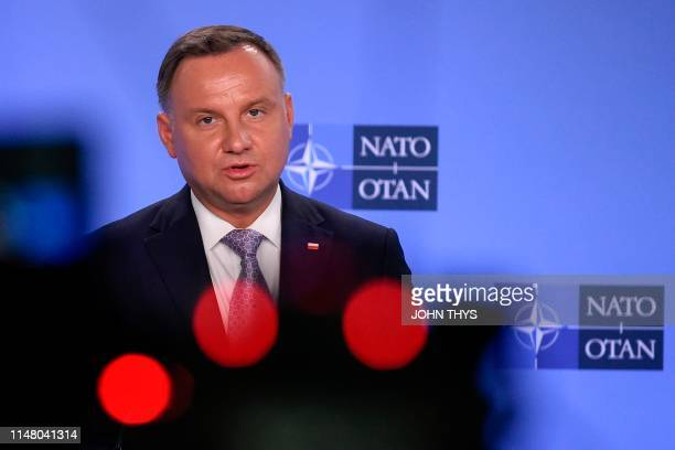 Polish President Andrzej Duda speaks during a joint press with NATO Secretary General after a bilateral meeting at the Nato headquarters in Brussels...