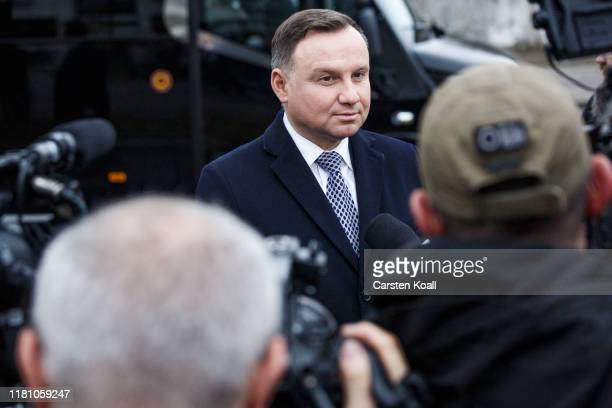 Polish President Andrzej Duda speaks with the media after a ceremony at the Visegrad monument during ceremonies to celebrate the 30th anniversary of...