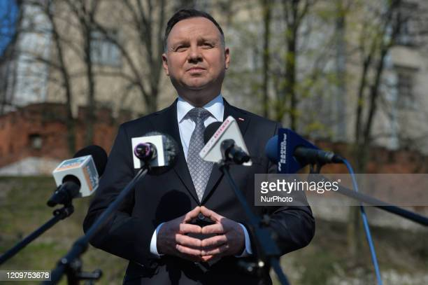 Polish President Andrzej Duda stops to address the media outside Wawel castle on his return from the visit of a sarcophagus where President Lech...