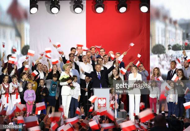Polish President backed by the right-wing Law and Justice party , Andrzej Duda, his wife, Agata Kornhauser Duda and party members celebrate with...