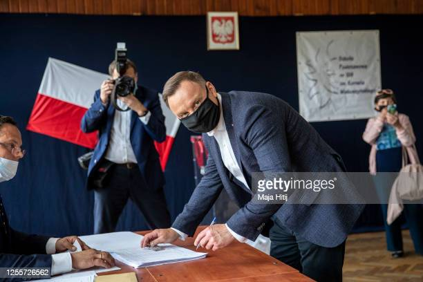 Polish President backed by the right-wing Law and Justice party , Andrzej Duda arrives to cast his ballot during Poland's Presidential elections...