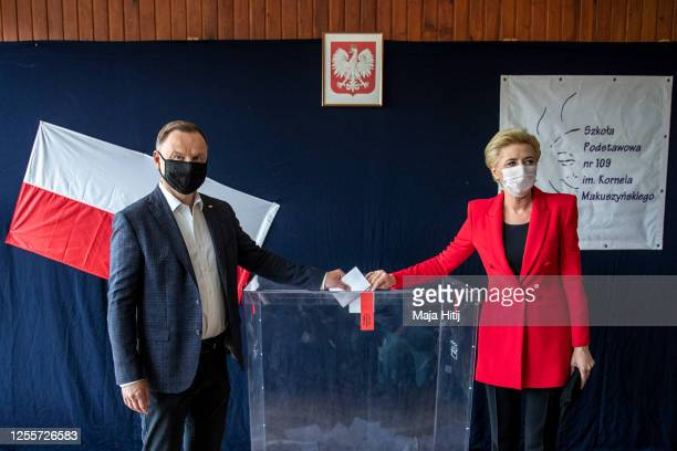 Polish President backed by the right-wing Law and Justice party , Andrzej Duda and his wife, Agata Kornhauser Duda, cast their ballot during Poland's...