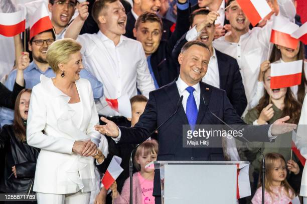 Polish President backed by the right-wing Law and Justice party , Andrzej Duda and his wife, Agata Kornhauser Duda celebrate with supporters the...