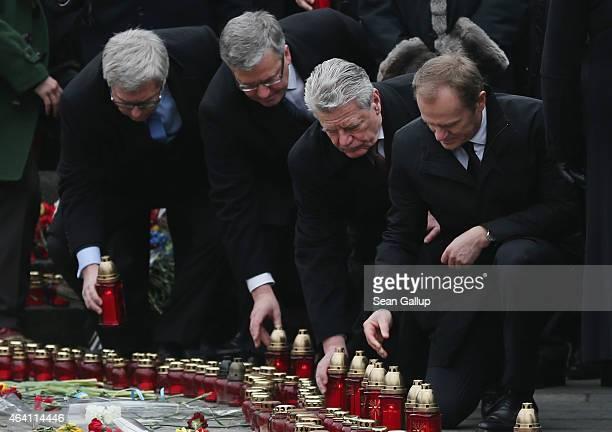 Polish President Bronislaw Komorowski German President Joachim Gauck and European Council President Donald Tusk lay candles at ceremonies marking the...