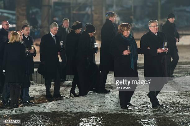 Polish President Bronislaw Komorowski together with Auschwitz survivors and families visit the Birkenau Memorial on January 27 2015 in Oswiecim...