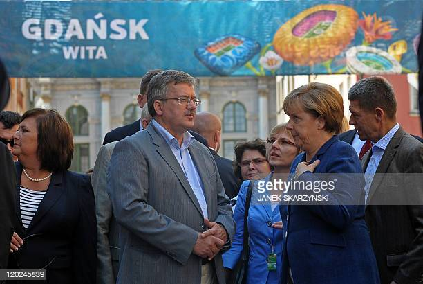 Polish President Bronislaw Komorowski with his wife Anna talk to German Chancellor Angela Merkel and her housband Joachim Sauer during a walk trough...