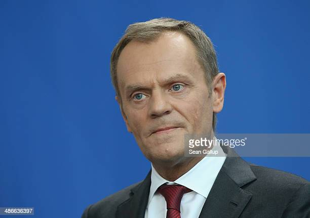 Polish President Donald Tusk and German Chancellor Angela Merkel give statements to the media upon Tusk's arrival at the Chancellery on April 25 2014...