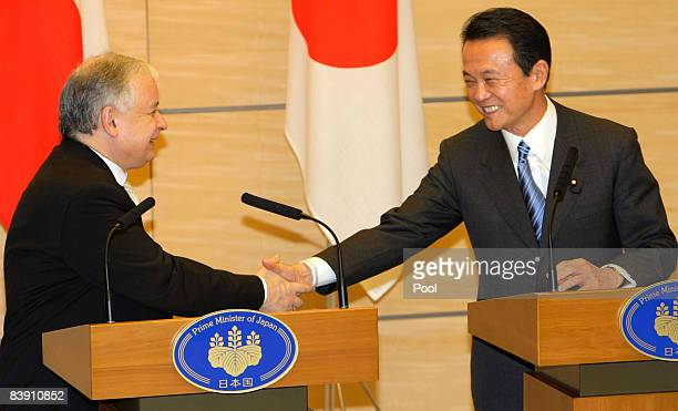 Polish President Lech Kaczynsk and Japanese Prime Minister Taro Aso shake hands at a press conference at Aso's official residence on December 4 2008...