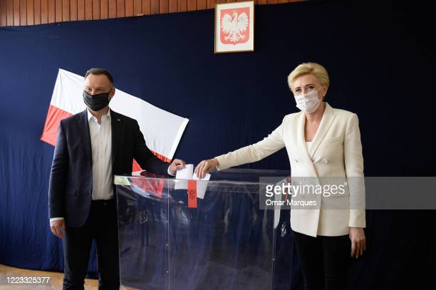 Polish President of the right-wing Law and Justice party Andrzej Duda and his wife, Agata Kornhauser Duda, cast their ballots in Poland's...
