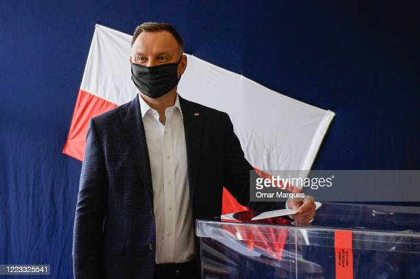 Polish President of the right-wing Law and Justice party Andrzej Duda casts his ballot in Poland's presidential election on June 28, 2020 in Krakow,...