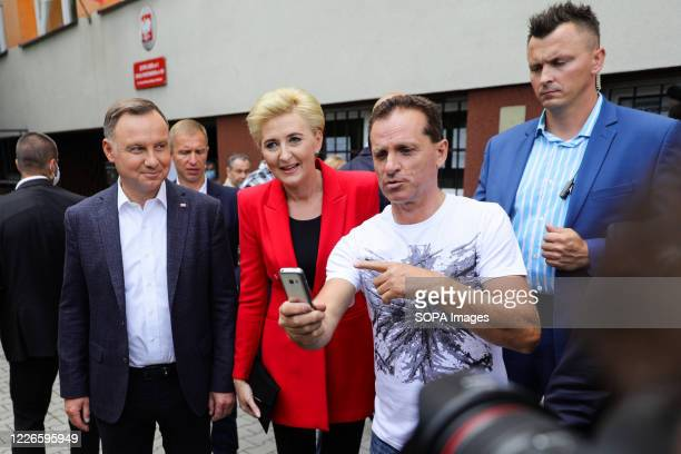 Polish presidential couple Andrzej Duda and Agata KornhauserDuda pose for a photo with their supporters after voting The incumbent President of...
